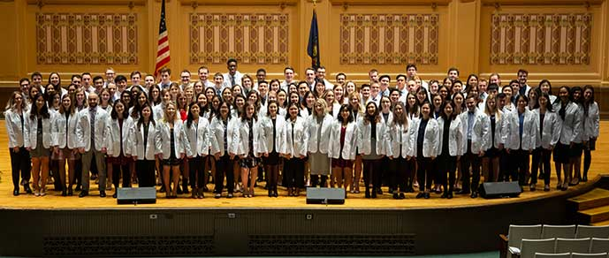 Class picture of students in white coats